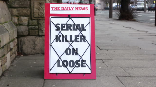 Newspaper headline board - Serial Killer on Loose