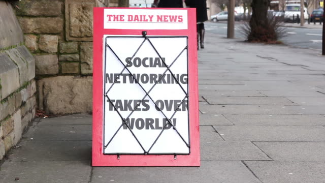 Newspaper Headline Board - Social networking takes over world
