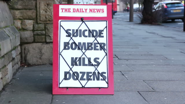 stockvideo's en b-roll-footage met newspaper headline board - suicide bomber kills dozens - terrorisme