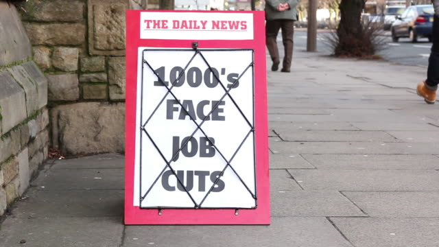 newspaper headline board - thousands face job cuts - unemployment stock videos and b-roll footage