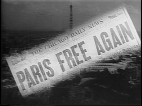 newspaper headline declares paris free again / french citizens gather in the streets of paris / military vehicles circle the arc de triomphe. - 1944 stock videos & royalty-free footage