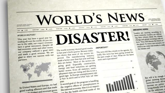 stockvideo's en b-roll-footage met newspaper headline: disaster - artikel
