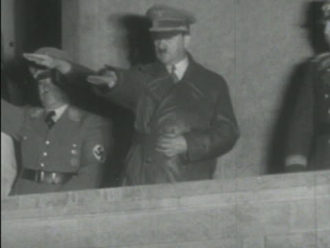 newspaper headline for kristallnacht / night, crowd saluting hitler as he salutes back, house burning, soldiers destroying jewish property, forcing... - nazism stock videos & royalty-free footage