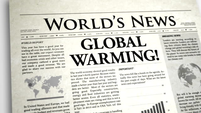 newspaper headline: global warming - press release stock videos and b-roll footage