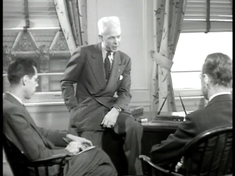 stockvideo's en b-roll-footage met newspaper headline 'homes emergencynew deal 'plot' ' reprising conversation editor edwin gavin sitting on desk in office saying opa formula wrong no... - 1946
