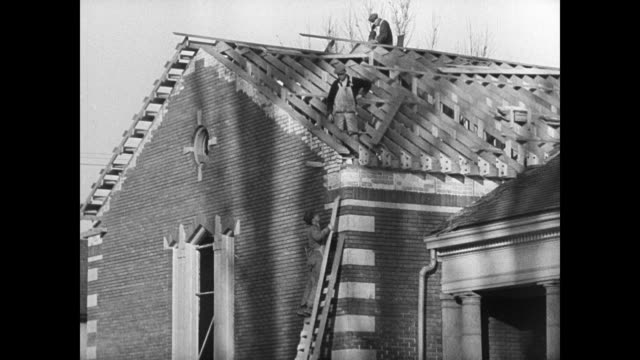 stockvideo's en b-roll-footage met newspaper headline hundred projects planned by church ext pioneer stake gymnasium mormon workers painting gym mormon carpenters building roof vs salt... - 1937