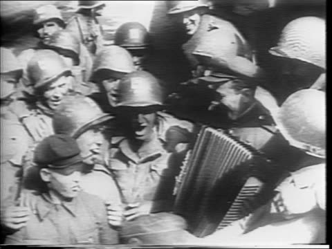 stockvideo's en b-roll-footage met newspaper headline on death of fdr / closeup of fdr / montage of funeral procession for fdr / montage of russan and american soldiers meeting and... - benito mussolini