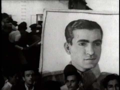 vidéos et rushes de a newspaper headline read mossadegh flees iran riots shah prepares flight home as the shah of iran mohammed reza pahlavi reads a document - 1953