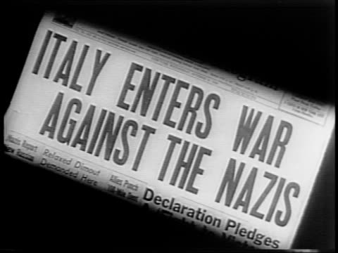 newspaper headline reads 'italy enters war against the nazis' / marshall pietro badoglio on train station platform surrounded by men, then a close-up... - 1943 stock videos & royalty-free footage