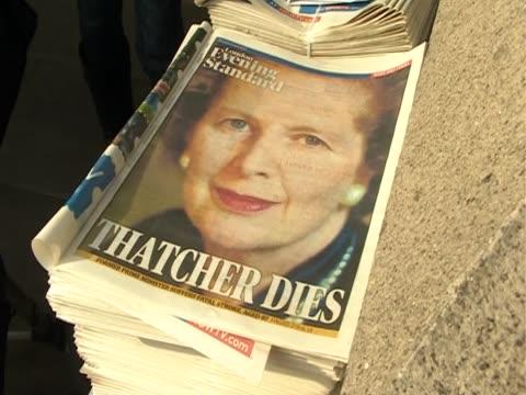 "newspaper headline reads ""thatcher dies"" after the death of margaret thatcher. - newspaper headline stock videos & royalty-free footage"