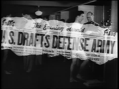 newspaper headline: us drafts defense army / draftees examined - western script stock videos & royalty-free footage