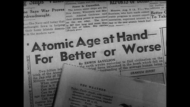 newspaper headlines addressing concerns about the dawn of the atomic age - atomic bomb stock videos & royalty-free footage
