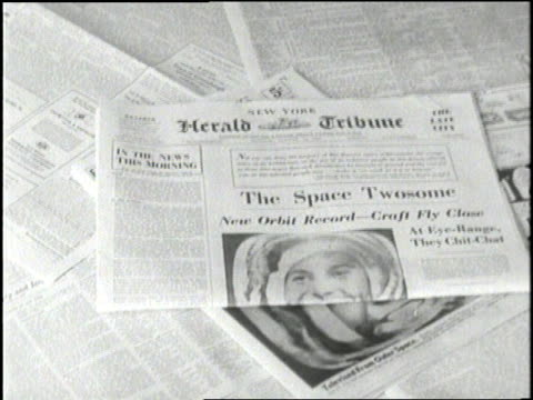 Newspaper headlines announce that two Soviet spacecrafts will circle the earth