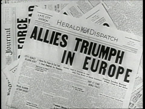 newspaper headlines announce the surrender of germany in world war two may 1945 - ve day stock-videos und b-roll-filmmaterial