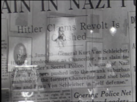 newspaper headlines are superimposed over scenes of nazi, fascist, and japanese terrorism. - vergangenheit stock-videos und b-roll-filmmaterial