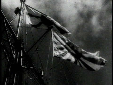 vídeos de stock, filmes e b-roll de newspaper headlines of japanese invasion la ms japanese flag blowing on cruiser ship vs japanese navy battleships firing cannons ws pan oil wells... - 1941