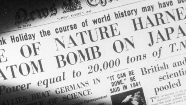 1956 cu newspaper headlining the dropping of the atom bomb on japan / united kingdom - 1945 stock videos and b-roll footage