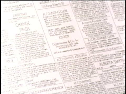 vídeos de stock, filmes e b-roll de newspaper helpwanted ads list a variety of jobs - classified ad