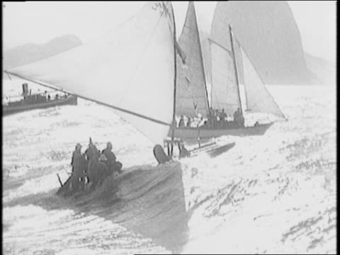 vídeos de stock, filmes e b-roll de newspaper insert / fishermen sail on small rafts in the ocean / larger boats sail up to meet fishing boat / men on fishing boat sailing in /... - 1941