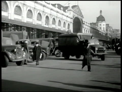 newspaper 'meat ration menaced by road strike.' trucks lined up meat warehouse. english truck men on strike walking in crowds. soldiers carrying... - newspaper strike stock videos & royalty-free footage