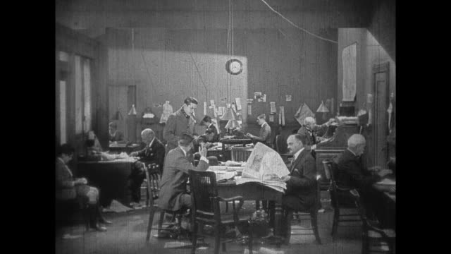 1925 newspaper men read strange tale about dinosaurs - 1925 stock videos & royalty-free footage