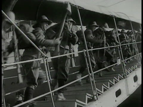 newspaper 'mussolini suez canal' italy soldiers in full gear rifles climbing stairs to ship italy destroyer battleship passing by people in turban... - benito mussolini stock videos & royalty-free footage