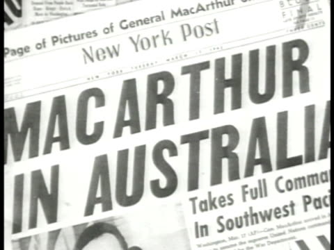 Newspaper 'New York Post MacArthur In Australia' INT MS General Douglas MacArthur at desk on telephone WWII
