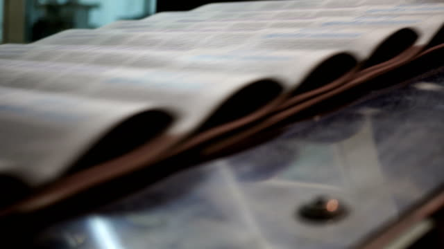 newspaper print process - folded paper stock videos and b-roll footage