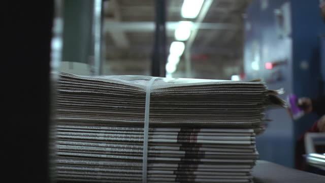 cu pan newspaper printing press, papers arriving in bundles on conveyor belt / usa - paper stock videos & royalty-free footage