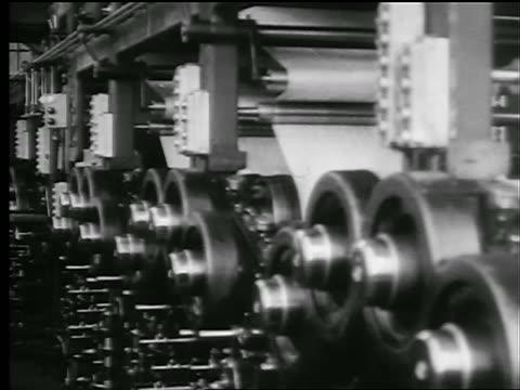 B/W 1927 PAN newspaper printing presses + men observing / newsreel