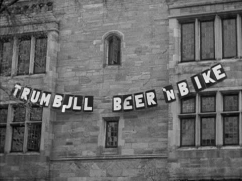 Newspaper sign 'Trumbull Beer 'N' Bike' VS Various squads some in costume preparing for bicycle race including the Rapid Rabbits team Extracurricular...