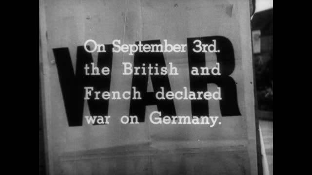 / newspaper stand poster with the single word 'war' / headlines from french and british newspapers / bombed out buildings falling in the background /... - 1939 stock videos & royalty-free footage