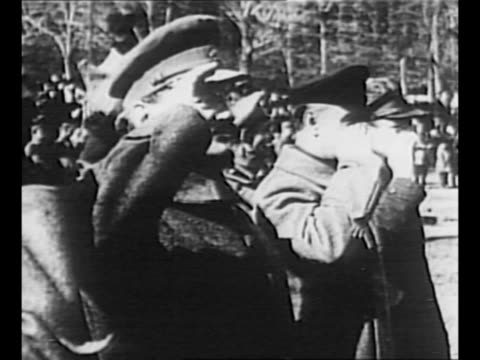 stockvideo's en b-roll-footage met newspaper story headlined million demand trotsky death / montage red army troops march in moscow in 1921 leon trotsky salutes as he reviews them with... - 1921