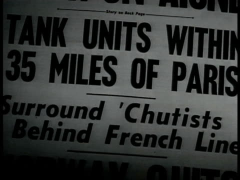 vídeos de stock, filmes e b-roll de newspaper 'tank units within 35 miles of paris' french soldiers on moving vehicle smoking sleeping french soldiers lying leisurely on field french... - primeira página de jornal