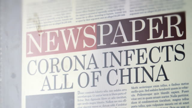 "vídeos de stock e filmes b-roll de newspaper title - ""corona infects all of china"" - jornal"