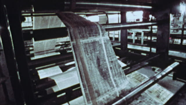 cu, composite, newspapers being printed, 1970's, los angeles, california, usa - pressa da stampa video stock e b–roll