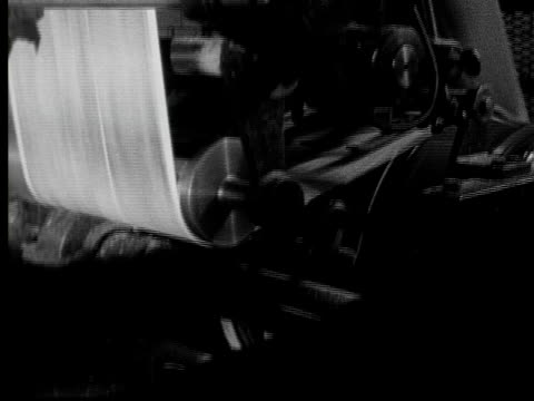 1955 cu pan newspapers being printed on printing press/ stream of folded papers moving on conveyor/ buffalo, new york - folded paper stock videos and b-roll footage