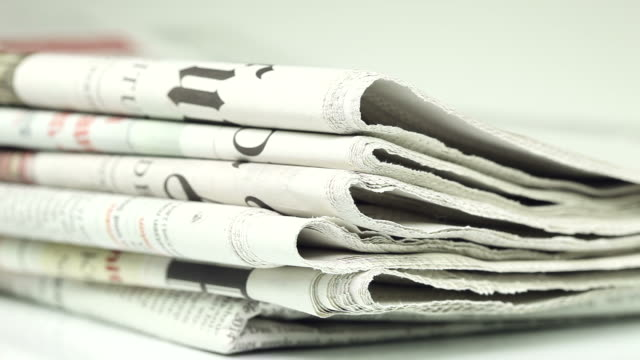 newspapers - close up - folded paper stock videos and b-roll footage