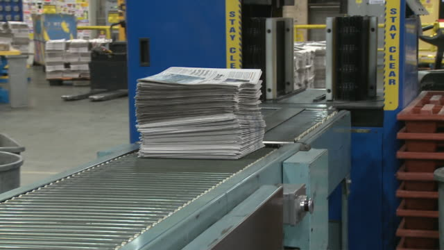 ms newspapers coming out of stacking machine onto conveyor belt at printing plant, san francisco, california, usa / audio - stack stock videos & royalty-free footage