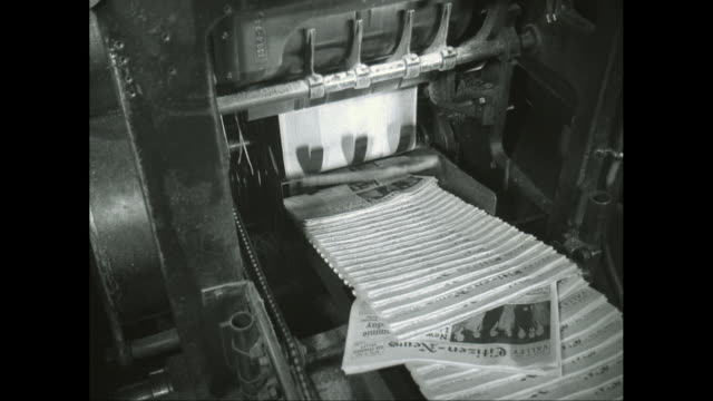MS TU TD Newspapers on conveyor belt in printing press / United States