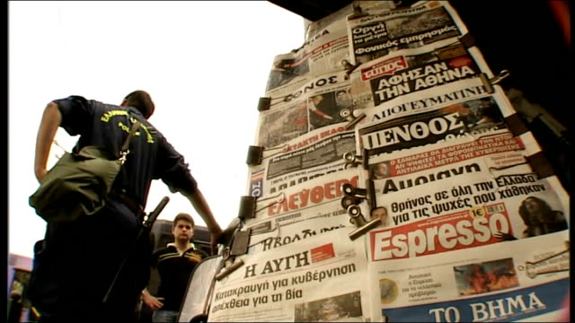 newspapers on stand and newspaper front pages on crisis newspaper stand with police office in front - newspaper strike stock videos & royalty-free footage