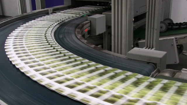MS Newspapers passing on conveyor belt in gravure printing office / Itzehoe, Schleswig-Holstein, Germany