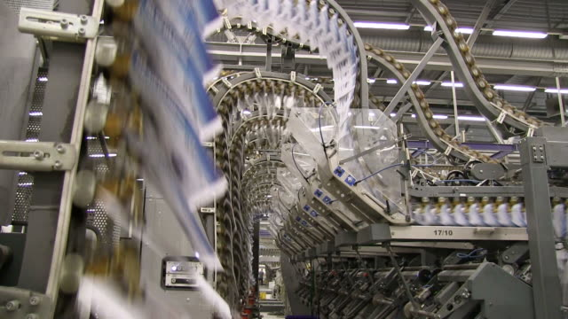 MS Newspapers passing on conveyor belt in gravure printing office / Itzehoe, Schleswig-Holstein, Germany