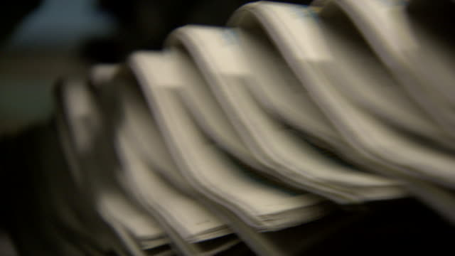 newspapers run off a production line, uk. - folded paper stock videos and b-roll footage