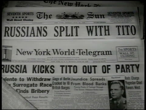 stockvideo's en b-roll-footage met newspapers 'russians split w/ tito russian kicks tito out of party moscow bloc disowns tito' iron curtain - joegoslavië