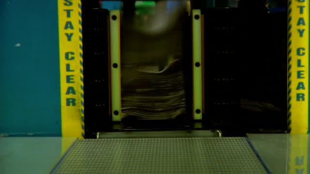 NewsPapers Stacked Inside Printing Press  LOOP