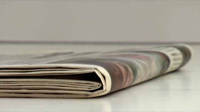 newspapers (hd,ntsc) - folded paper stock videos and b-roll footage