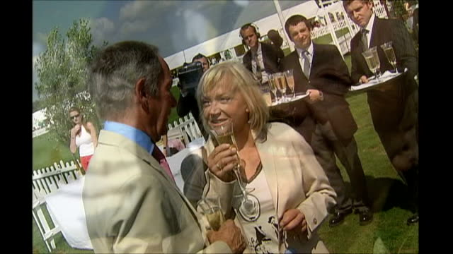itn newsreader carol barnes dies ext carol barnes chatting with bbc newsreader michael buerk at polo event reporting to camera by mobile health unit... - michael buerk stock videos & royalty-free footage