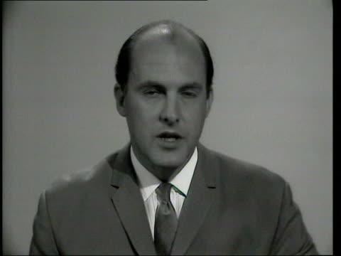 newsreader gordon honeycombe memories; lib / 1960's london: int b/w gordon honeycombe announces hurricane in louisiana sot - newsreader stock videos & royalty-free footage