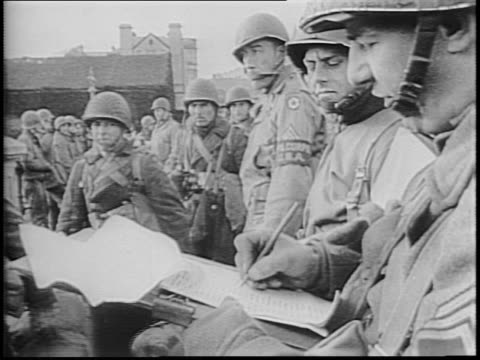 vídeos de stock e filmes b-roll de newsreel / allied troops prepare load and board ships headed out for invasion across the english channel / - 1944